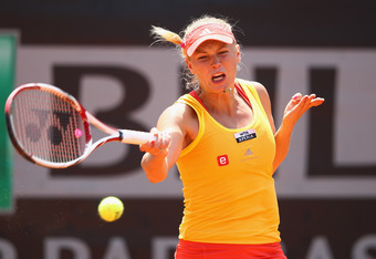 ROME, ITALY - MAY 16:  Caroline Wozniacki of Denmark plays a forehand in her match against Anabel Medina Garrigues of Spain during day five of the Internazionali BNL d'Italia 2012 Tennis on May 16, 2012 in Rome, Italy.  (Photo by Julian Finney/Getty Image
