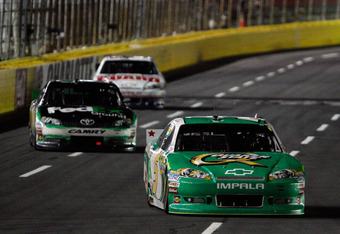 CONCORD, NC - MAY 27:  Kasey Kahne, driver of the #5 Quaker State Chevrolet, leads a group of cars during the NASCAR Sprint Cup Series Coca-Cola 600 at Charlotte Motor Speedway on May 27, 2012 in Concord, North Carolina.  (Photo by Chris Graythen/Getty Im