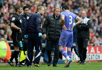 SUNDERLAND, ENGLAND - APRIL 07:  Tottenham manager Harry Redknapp speaks with Gareth Bale the player is lead from the field after receiving an injury in a tackle with Craig Gardner of Sunderland during the Barclay's Premier League match between Sunderland