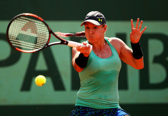 PARIS, FRANCE - MAY 28:  Bethanie Mattek-Sands of USA plays a forehand in the women's singles first round match between Sabine Lisicki of Germany and Bethanie Mattek-Sands of USA during day two of the French Open at Roland Garros on May 28, 2012 in Paris,