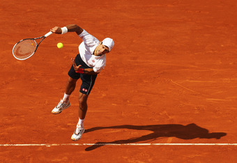 PARIS, FRANCE - MAY 28:  Novak Djokovic of Serbia serves in his men's singles first round match against Potito Starace of Italy during day 2 of the French Open at Roland Garros on May 28, 2012 in Paris, France.  (Photo by Matthew Stockman/Getty Images)
