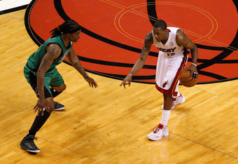 MIAMI, FL - MAY 28:  Mario Chalmers #15 of the Miami Heat looks to pas the ball Marquis Daniels #4 of the Boston Celtics in Game One of the Eastern Conference Finals in the 2012 NBA Playoffs on May 28, 2012 at American Airlines Arena in Miami, Florida.  N