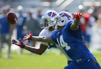 PITTSFORD, NY - AUGUST 08: Loyce Means #44 of the Buffalo Bills breaks up a pass intended for Craig Davis #85  during Buffalo Bills Training Camp at St. John Fisher College on August 8, 2011 in Pittsford, New York.  (Photo by Rick Stewart/Getty Images)