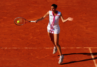 PARIS, FRANCE - MAY 29:  Virginie Razzano of France plays a forehand in her women's singles first round match between Serena Williams of USA and Virginie Razzano of France during day three of the French Open at Roland Garros on May 29, 2012 in Paris, Fran
