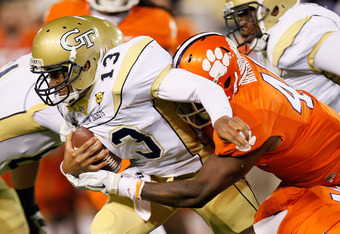 ATLANTA, GA - OCTOBER 29:  Tevin Washington #13 of the Georgia Tech Yellow Jackets is sacked by Andre Branch #40 of the Clemson Tigers at Bobby Dodd Stadium on October 29, 2011 in Atlanta, Georgia.  (Photo by Kevin C. Cox/Getty Images)