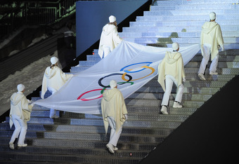 INNSBRUCK, AUSTRIA - JANUARY 13:  The Olympic Flag enters the stadium during the Winter Youth Olympic Games Opening Ceremony at the Bergisel Stadium on January 13, 2012 in Innsbruck, Austria.  (Photo by Shaun Botterill/Getty Images)