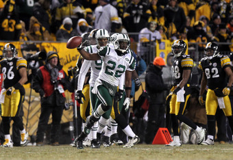 PITTSBURGH, PA - JANUARY 23:  Brodney Pool #22 of the New York Jets celebrates after intercepting a pass intended for Emmanuel Sanders #88 of the Pittsburgh Steelers in the third quarter of the 2011 AFC Championship game at Heinz Field on January 23, 2011