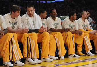 LOS ANGELES, CA - APRIL 06:  Los Angeles Lakers wear 'NBA Green' shirts on the bench during the game against the Houston Rockets at Staples Center on April 6, 2012 in Los Angeles, California.  NOTE TO USER: User expressly acknowledges and agrees that, by