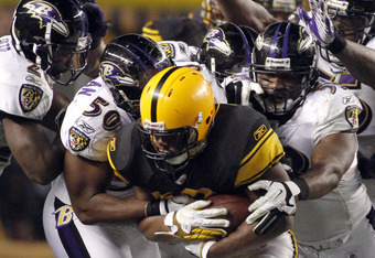 PITTSBURGH, PA - NOVEMBER 6:   Isaac Redman #33 of the Pittsburgh Steelers is stopped by the Baltimore Ravens defense during the game on November 6, 2011 at Heinz Field in Pittsburgh, Pennsylvania.  The Ravens defeated the Steelers 23-20.  (Photo by Justi
