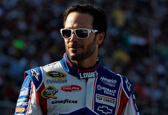 CONCORD, NC - MAY 27:  Jimmie Johnson, driver of the #48 Lowe's Patriotic Chevrolet, stands on the grid during the NASCAR Sprint Cup Series Coca-Cola 600 at Charlotte Motor Speedway on May 27, 2012 in Concord, North Carolina.  (Photo by Chris Graythen/Get