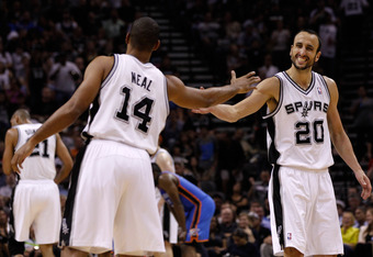 SAN ANTONIO, TX - MAY 29:  Manu Ginobili #20 and Gary Neal #14 of the San Antonio Spurs celebrate a play in the second half while taking on the Oklahoma City Thunder in Game Two of the Western Conference Finals of the 2012 NBA Playoffs at AT&T Center on M