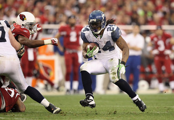 GLENDALE, AZ - JANUARY 01:  Runningback Marshawn Lynch #24 of the Seattle Seahawks rushes the football against the Arizona Cardinals during the NFL game at the University of Phoenix Stadium on January 1, 2012 in Glendale, Arizona. The Cardinals defeated t