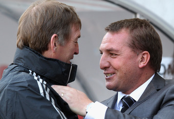 SWANSEA, WALES - MAY 13:  Swansea City Manager Brendan Rodgers (r) chats to Liverpool Manager Kenny Dalglish prior to the Barclays Premier League match between Swansea City and Liverpool at the Liberty Stadium on May 13, 2012 in Swansea, Wales.  (Photo by