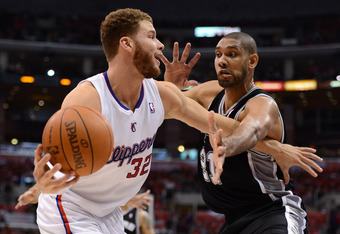 LOS ANGELES, CA - MAY 20:  Blake Griffin #32 of the Los Angeles Clippers moves the ball against Tim Duncan #21 of the San Antonio Spurs in the third quarter in Game Four of the Western Conference Semifinals in the 2012 NBA Playoffs on May 20, 2011 at Stap