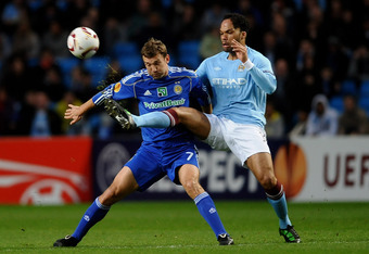 MANCHESTER, ENGLAND - MARCH 17:  Andriy Shevchenko of Dynamo Kiev is challenged by Joleon Lescott of Manchester City during the UEFA Europa League round of 16 second leg match between Manchester City and Dynamo Kiev at City of Manchester Stadium on March