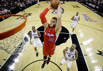 SAN ANTONIO, TX - MAY 15:  Blake Griffin #32 of the Los Angeles Clippers dunks the ball ahead of Kawhi Leonard #2, Boris Diaw #33 and Tony Parker #9 of the San Antonio Spurs in Game One of the Western Conference Semifinals in the 2012 NBA Playoffs at AT&T