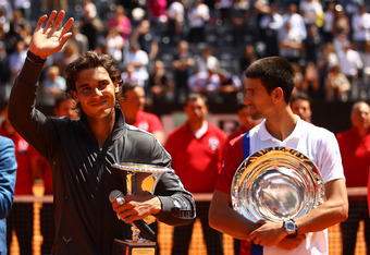 ROME, ITALY - MAY 21:  Rafael Nadal of Spain lifts the trophy after defeating Novak Djokovic of Serbia in their final match during day ten of the Internazionali BNL d'Italia 2012 at the Foro Italico Tennis Centre on May 21, 2012 in Rome, Italy.  (Photo by