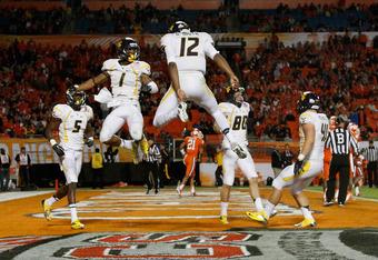 Tavon Austin and Geno Smith celebrate at the Discover Orange Bowl