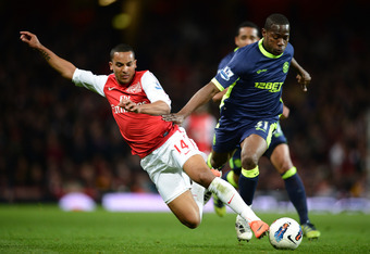 LONDON, ENGLAND - APRIL 16: Theo Walcott of Arsenal is tackled by Maynor Figueroa of Wigan during the Barclays Premier League match between Arsenal and Wigan Athletic at Emirates Stadium on April 16, 2012 in London, England.  (Photo by Laurence Griffiths/
