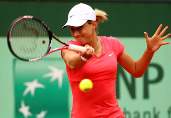 PARIS, FRANCE - JUNE 01:  Petra Martic of Croatia plays a forehand during her women's singles third round match against Anabel Medina Garrigues of Spain during day 6 of the French Open at Roland Garros on June 1, 2012 in Paris, France.  (Photo by Clive Br