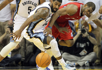 MEMPHIS, TN - MAY 02:  O.J. Mayo #32 of the Memphis Grizzlies and Chris Paul #3 of the Los Angeles Clippers battle for a loose ball in Game Two of the Western Conference Quarterfinals in the 2012 NBA Playoffs at FedExForum on May 2, 2012 in Memphis, Tenne