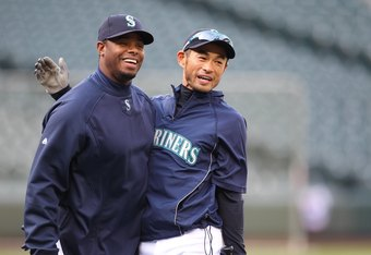 SEATTLE - APRIL 14:  Ken Griffey Jr. #24 (L) of the Seattle Mariners talks with Ichiro Suzuki #51 during batting practice prior to the game against the Oakland Athletics at Safeco Field on April 14, 2010 in Seattle, Washington. (Photo by Otto Greule Jr/Ge
