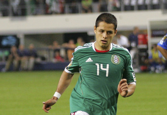 ARLINGTON, TX - JUNE 05:  Javier Hernandez #14 of Mexico takes a a penalty kick and scores against El Salvador during the CONCACAF Gold Cup qualifying match at Cowboys Stadium on June 5, 2011 in Arlington, Texas.  (Photo by Rick Yeatts/Getty Images)