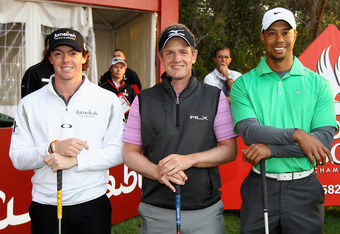 ABU DHABI, UNITED ARAB EMIRATES - JANUARY 26:  L-R Rory McIlroy of Northern Ireland; Luke Donald of England and Tiger Woods of the USA pose for a photograph on the first tee during the first round of The Abu Dhabi HSBC Golf Championship at Abu Dhabi Golf
