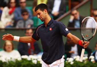 PARIS, FRANCE - JUNE 03:  Novak Djokovic of Serbia shows his frustration in his men's singles fourth round match against Andreas Seppi of Italy during day 8 of the French Open at Roland Garros on June 3, 2012 in Paris, France.  (Photo by Clive Brunskill/G