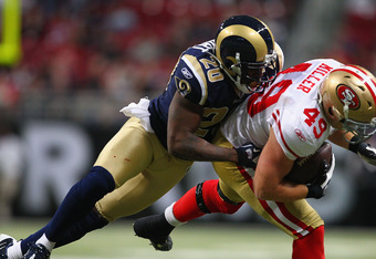 ST. LOUIS, MO - JANUARY 1: Darian Stewart #20 of the St. Louis Rams tackles Bruce Miller #49 of the San Francisco 49ers at the Edward Jones Dome on January 1, 2012 in St. Louis, Missouri.  The 49ers beat the Rams 34-27.  (Photo by Dilip Vishwanat/Getty Im