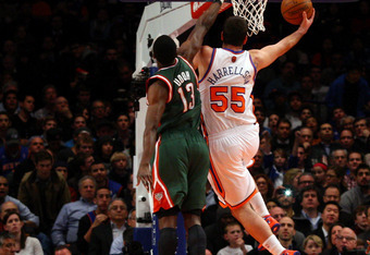 NEW YORK, NY - MARCH 26:  Josh Harrellson #55 of the New York Knicks drives for a shot attempt against Ekpe Udoh #13 of the Milwaukee Bucks at Madison Square Garden on March 26, 2012 in New York City. NOTE TO USER: User expressly acknowledges and agrees t