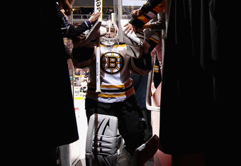 GLENDALE, AZ - DECEMBER 28:  Goaltender Tim Thomas #30 of the Boston Bruins walks back to the locker room before the NHL game against the Phoenix Coyotes at Jobing.com Arena on December 28, 2011 in Glendale, Arizona. The Bruins defeated the Coyotes 2-1 in