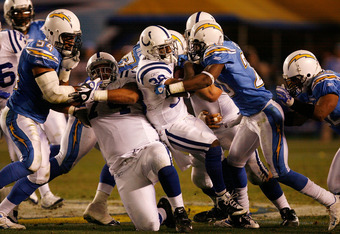 SAN DIEGO - JANUARY 03:  Dominic Rhodes #38 of the Indianapolis Colts rushes for a first down against the San Diego Chargers during their AFC Wild Card Game on January 3, 2009 at Qualcomm Stadium in San Diego, California.  (Photo by Harry How/Getty Images