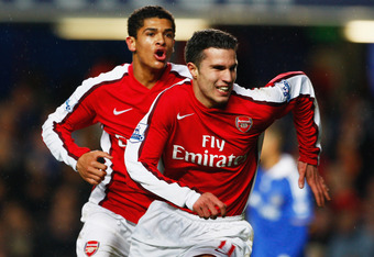 LONDON - NOVEMBER 30:  Robin Van Persie of Arsenal (R) celebrates with teammate Denilson after scoring his team's opening goal during the Barclays Premier League match between Chelsea and Arsenal at Stamford Bridge on November 30, 2008 in London, England.