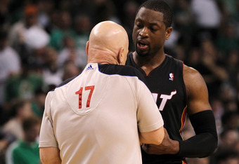 BOSTON, MA - JUNE 03:  Dwyane Wade #3 of the Miami Heat talks with referee Joe Crawford #17 against the Boston Celtics in Game Four of the Eastern Conference Finals in the 2012 NBA Playoffs on June 3, 2012 at TD Garden in Boston, Massachusetts. NOTE TO US