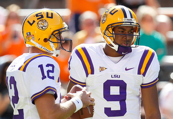 KNOXVILLE, TN - OCTOBER 15:  Jarrett Lee #12 and Jordan Jefferson #9 of the LSU Tigers warms up prior to facing the Tennessee Volunteers at Neyland Stadium on October 15, 2011 in Knoxville, Tennessee.  (Photo by Kevin C. Cox/Getty Images)
