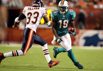 MIAMI - NOVEMBER 18:  Receiver Brandon Marshall #19 of the Miami Dolphins runs as safety Charles Tillman #33 of the Chicago Bears defends at Sun Life Stadium on November 18, 2010 in Miami, Florida.  (Photo by Marc Serota/Getty Images)