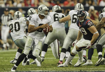 HOUSTON - OCTOBER 09: Quarterback Jason Campbell #8 of the Oakland Raiders during action against the Houston Texans at Reliant Stadium on October 9, 2011 in Houston, Texas. (Photo by Bob Levey/Getty Images)