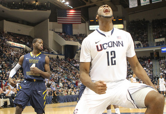 HARTFORD, CT - JANUARY 9:  Andre Drummond #12 of the Connecticut Huskies reacts after scoring despite the defense of Jabarie Hinds #4 of the West Virginia Mountaineers at the XL Center on January 9, 2012 in Hartford, Connecticut.  (Photo by Jim Rogash/Get