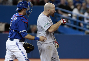 TORONTO, CANADA - JUNE 3: J.P. Arencibia #9 of the Toronto Blue Jays tries to calm Kevin Youkilis #20 of the Boston Red Sox after he was hit by a pitch during MLB action at The Rogers Centre June 3, 2012 in Toronto, Ontario, Canada. (Photo by Abelimages/G