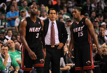 BOSTON, MA - JUNE 03:  (L-R) Dwyane Wade #3, Erik Spoelstra and Mario Chalmers #15 of the Miami Heat look on against the Boston Celtics  in Game Four of the Eastern Conference Finals in the 2012 NBA Playoffs on June 3, 2012 at TD Garden in Boston, Massach