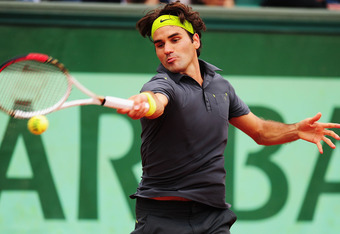 PARIS, FRANCE - JUNE 05:  Roger Federer of Switzerland plays a forehand in his men's singles quarter final match against Juan Martin Del Potro of Argentina during day 10 of the French Open at Roland Garros on June 5, 2012 in Paris, France.  (Photo by Mike