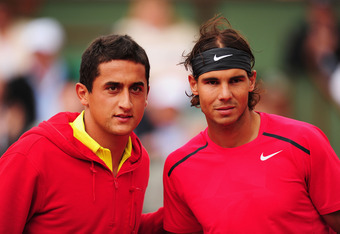 PARIS, FRANCE - JUNE 06:  Rafael Nadal (R) and Nicolas Almagro of Spain pose prior to their men's singles quarter final match during day 11 of the French Open at Roland Garros on June 6, 2012 in Paris, France.  (Photo by Mike Hewitt/Getty Images)