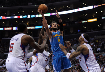 LOS ANGELES, CA - APRIL 22:  Marco Belinelli #8 of the New Orleans Hornets scores on a drive in front of Kenyon Martin #2 and DeAndre Jordan #6 of the Los Angeles Clippers at Staples Center on April 22, 2012 in Los Angeles, California.  NOTE TO USER: User