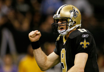 NEW ORLEANS, LA - JANUARY 07:   Drew Brees #9 of the New Orleans Saints celebrates after a touchdown in the second quarter against the Detroit Lions during their 2012 NFC Wild Card Playoff game at Mercedes-Benz Superdome on January 7, 2012 in New Orleans,