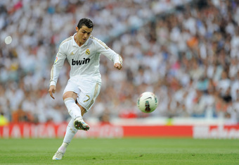 MADRID, SPAIN - MAY 13:  Cristiano Ronaldo of Real Madrid CF passes the ball during the La Liga match between Real Madrid CF and RCD Mallorca at Estadio Santiago Bernabeu on May 13, 2012 in Madrid, Spain.  (Photo by Denis Doyle/Getty Images)