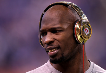 INDIANAPOLIS, IN - FEBRUARY 05:  Chad Ochocinco #85 of the New England Patriots waits on the field during warmups before the New England Patriots take on the New York Giants in Super Bowl XLVI at Lucas Oil Stadium on February 5, 2012 in Indianapolis, Indi