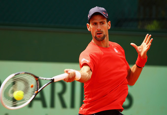 PARIS, FRANCE - JUNE 05:  Novak Djokovic of Serbia plays a forehand in a practice session prior to his men's singles quarter final match against Jo-Wilfried Tsonga of France during day 10 of the French Open at Roland Garros on June 5, 2012 in Paris, Franc