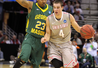 CLEVELAND, OH - MARCH 20:  Aaron Craft #4 of the Ohio State Buckeyes handles the ball against Rashad Whack #23 of the George Mason Patriots during the third of the 2011 NCAA men's basketball tournament at Quicken Loans Arena on March 20, 2011 in Cleveland