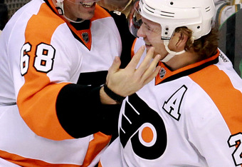 DALLAS, TX - DECEMBER 21:  Jaromir Jagr #68 of the Philadelphia Flyers celebrates his goal with Claude Giroux #28 during play against the Dallas Stars at American Airlines Center on December 21, 2011 in Dallas, Texas.  (Photo by Ronald Martinez/Getty Imag